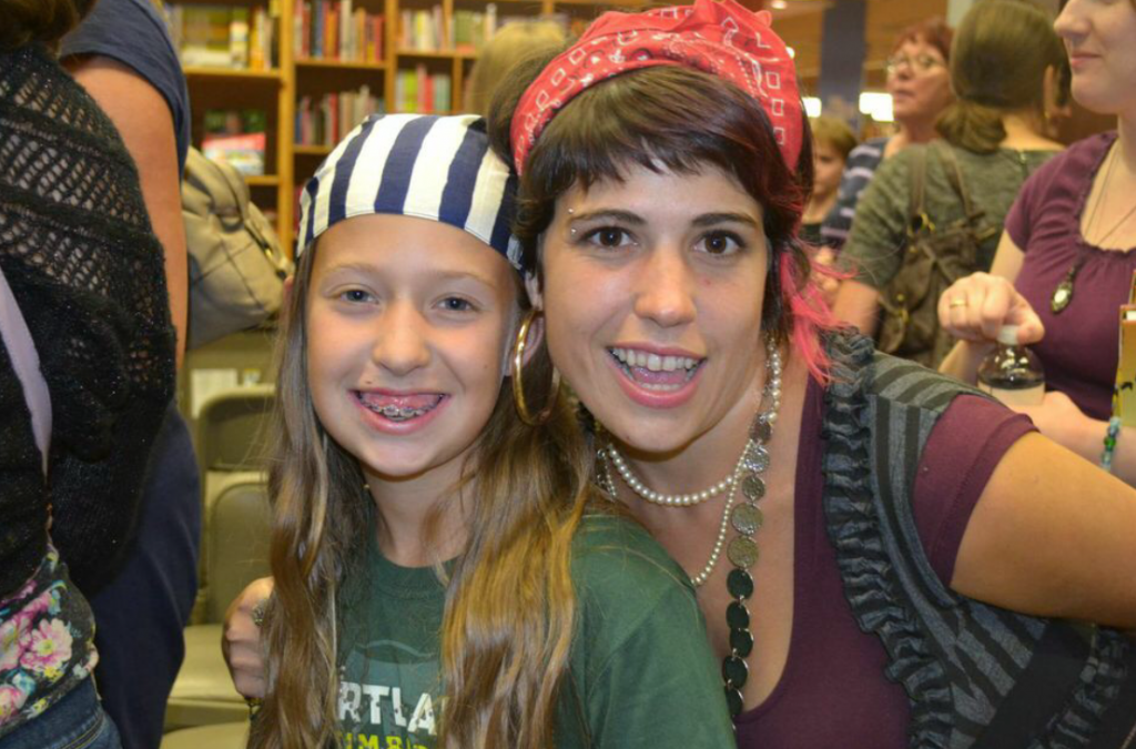 Author Kiersi Burkhart and her young pirate friend. Photo by Kelly Garrett